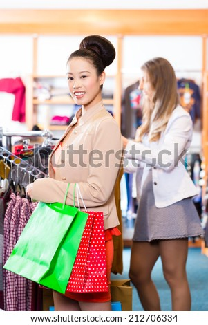 Asian Woman with shopping bags in shop