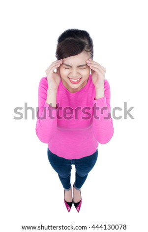 Asian woman with stress isolated. High angle view fish eye like image of stressed young woman isolated on white background. - stock photo