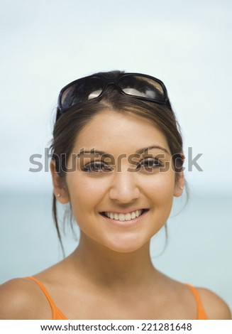 Asian woman with sunglasses on head - stock photo