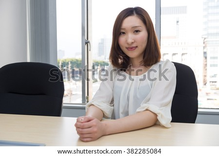 asian woman with table