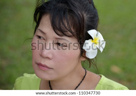 Asian woman with white flowers in her hair
