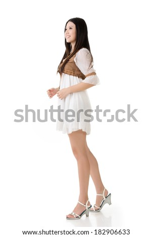 Asian woman with white short dress, full length portrait isolated on white.