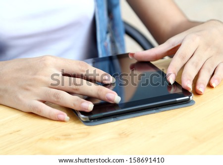 asian woman working touch her tablet and search information at coffee shop