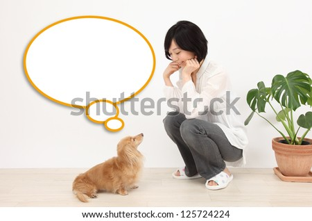 Asian women and dogs and speech balloon - stock photo
