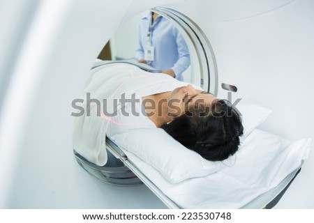 Asian women are entering the brain with a Ct scan - stock photo