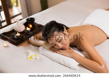 Asian women are prone to prepare an oil massage. She is smiling and happy - stock photo