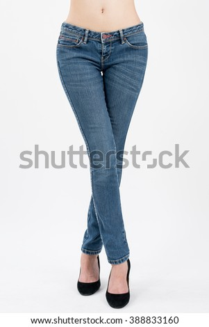 asian women crossing her leg in jeans front views,isolated on white background. - stock photo