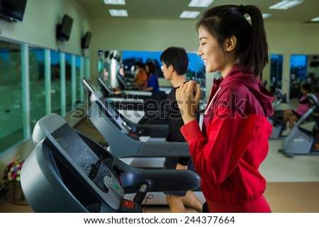 Asian women Exercise by running on a treadmill - stock photo
