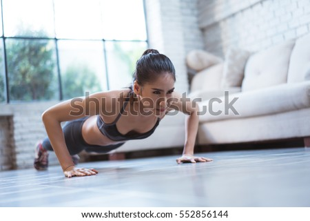 "Asian women exercise indoor at home she is acted ""push up"""