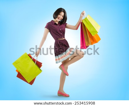Asian women Glad to have shopping in the mall. She ran with a bag - stock photo