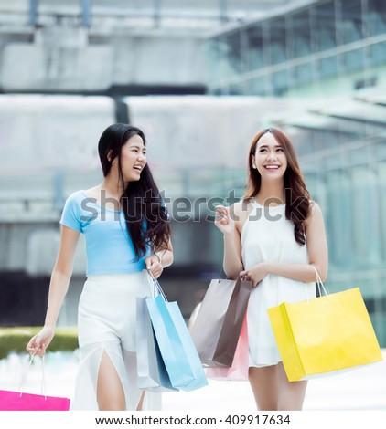 Asian women going shopping fun mall she feels very happy - stock photo