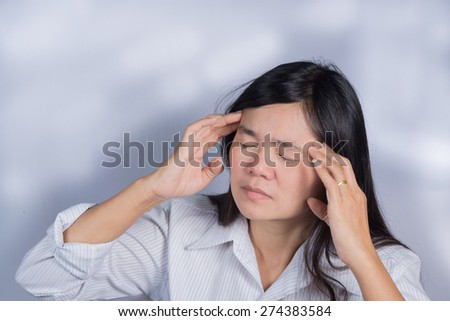 Asian women  have a sore eyes. - stock photo
