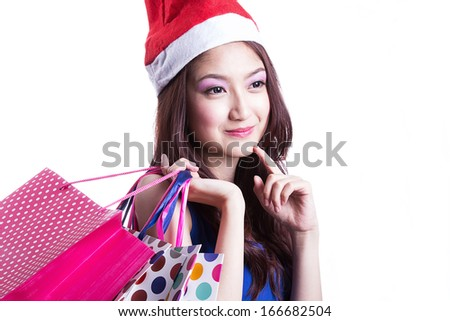 Asian women on holding a lot of shopping bag in Super market