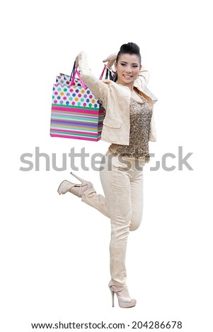 Asian women on holding a lot of shopping bag on white background with paths