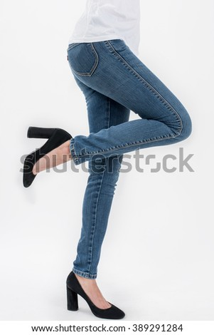 asian women posing lift her leg in jeans and white T-shirt front views,isolated on white background. - stock photo