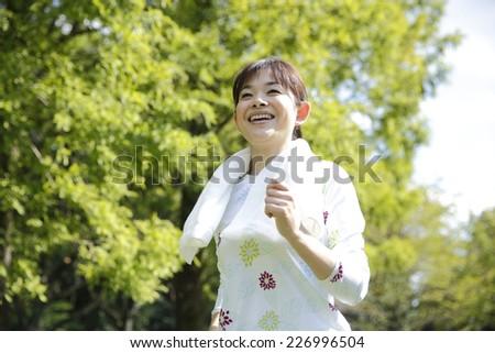 Asian women running - stock photo