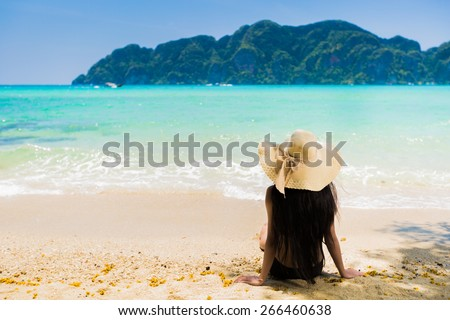 sitting on beach nude