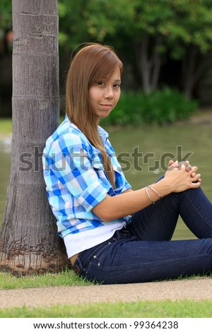 asian women wearing a blue plaid shirts and dark blue jeans