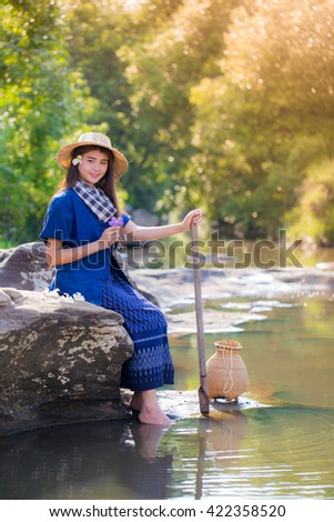 Asian women working in creek