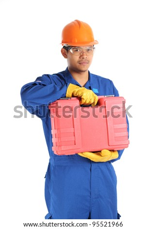 asian worker complete with personal protective equipment and tool box ready to work on safety concept - stock photo