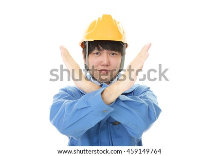 Asian worker making stop sign with crossed hands