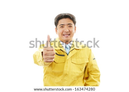 Asian worker with thumbs up