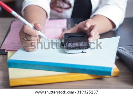 Asian worker writing documents
