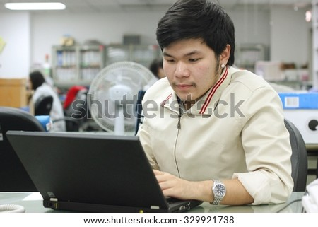 Asian working man 20-30s with computer laptop in the office - stock photo
