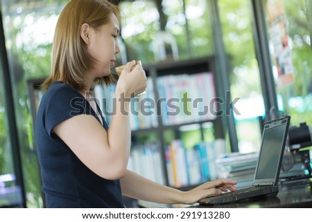 Asian working woman have a coffee at cafe