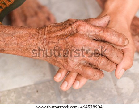 Asian 100 years old hand, family concept with blurred background.