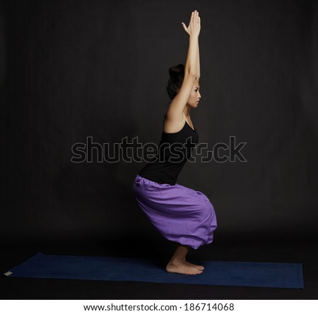 Asian young beautiful yoga posing on a black studio background studio