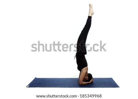 Asian young beautiful yoga posing on a white studio background. - stock photo