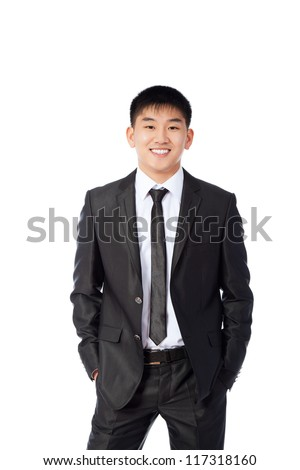 asian young business man happy smile, businessman hold hands in pockets wear elegant suit and tie isolated over white background - stock photo