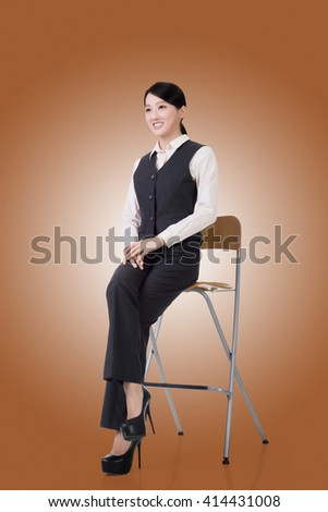 asian young business woman sit on a chair, full length portrait - stock photo