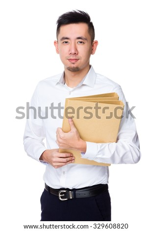Asian Young Businessman hold with document work