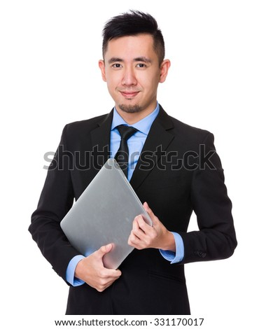 Asian Young Businessman hold with laptop computer