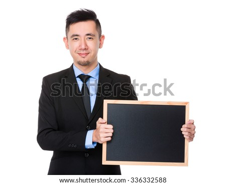 Asian Young Businessman showing the blank black board