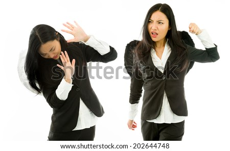 Asian young businesswoman dressed as black angel punching the white angel isolated on white background
