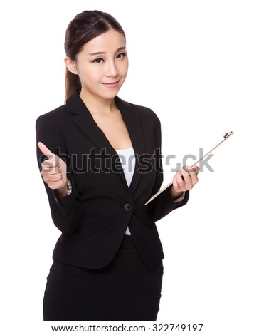 Asian young businesswoman hold with clipboard and thumb up