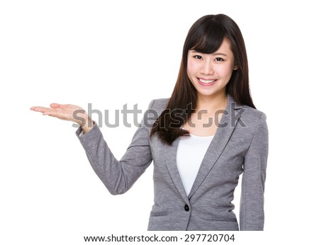 Asian young businesswoman with hand showing blank sign - stock photo
