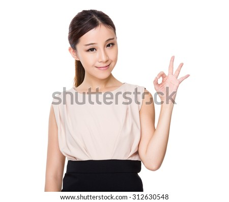 Asian young Businesswoman with ok sign gesture - stock photo
