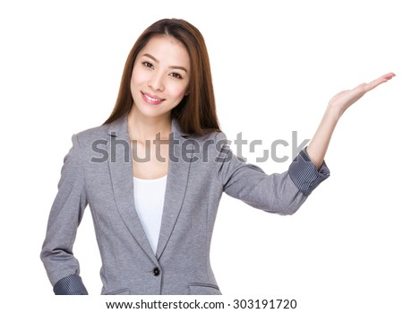 Asian young businesswoman with open hand palm - stock photo