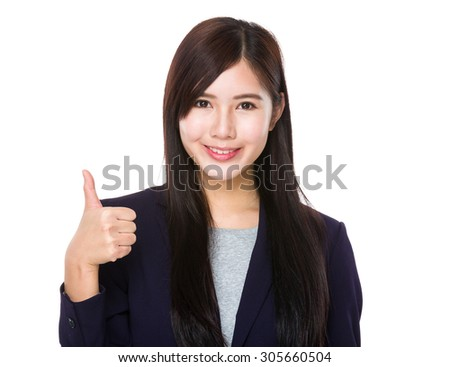 Asian young businesswoman with thumb up gesture - stock photo
