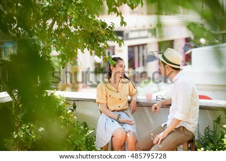 asian young couple having first date in the park