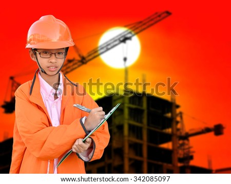 asian young engineer on construction background