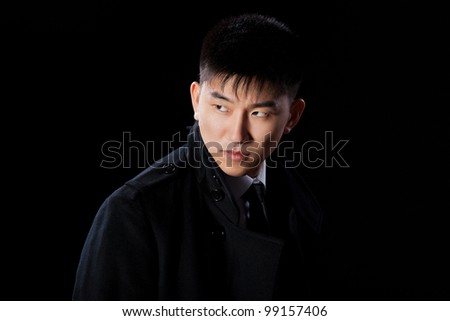 asian young fashion business man confident serious, portrait of angry businessman wear elegant jacket coat suit and tie over black background