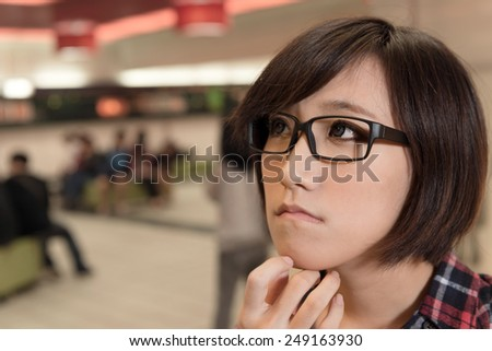 Asian young girl at street in modern city. - stock photo