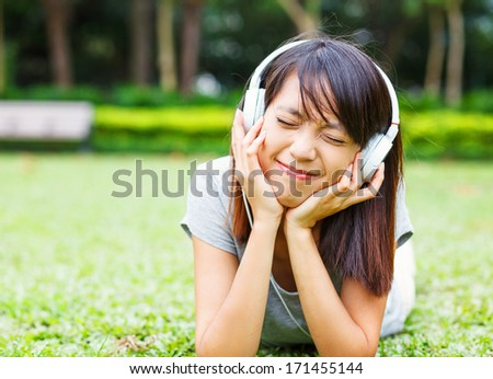 Asian young girl enjoy listen to music - stock photo