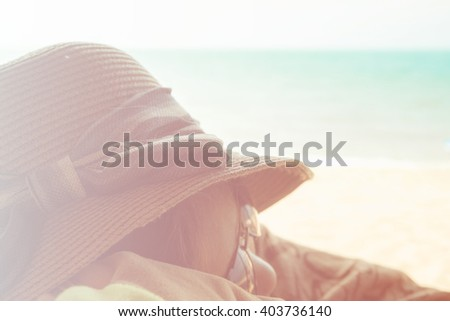 asian young girl sleeping on the beach vintage tone,summer concept - stock photo