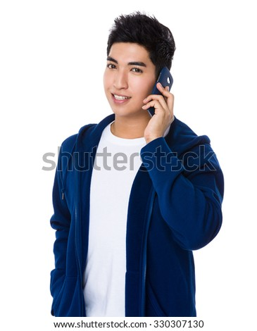 Asian Young Man chat on mobile phone - stock photo
